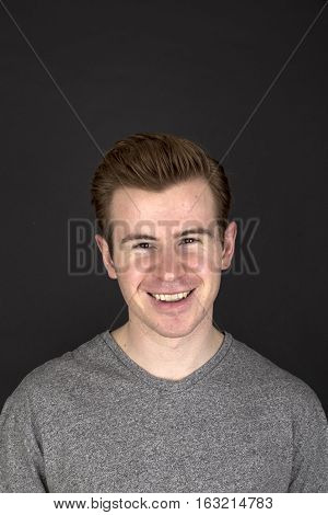 Portrait  Of Positive Looking Young Man