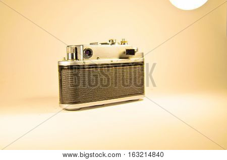Old soviet rangefinder camera isolated on a white background