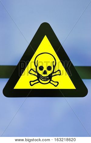 Focus at the label toxic chemicals in laboratory