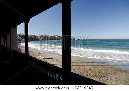 Watching low tide from a gallery of a beach resort in Southern California near San Diego
