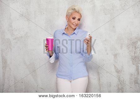 Elegant Blonde Businesswoman Posing.