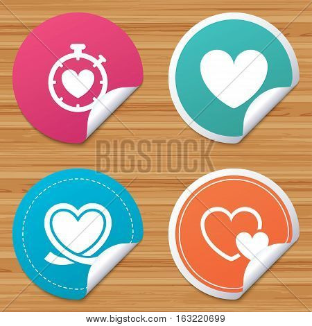 Round stickers or website banners. Heart ribbon icon. Timer stopwatch symbol. Love and Heartbeat palpitation signs. Circle badges with bended corner. Vector