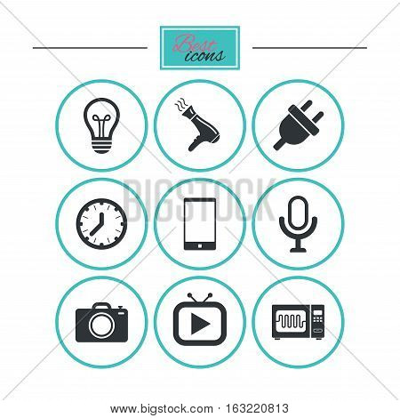 Home appliances, device icons. Electronics signs. Lamp, electrical plug and photo camera symbols. Round flat buttons with icons. Vector