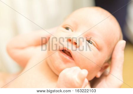 Cute Newborn Baby In Mother's Hands. Stock Photo