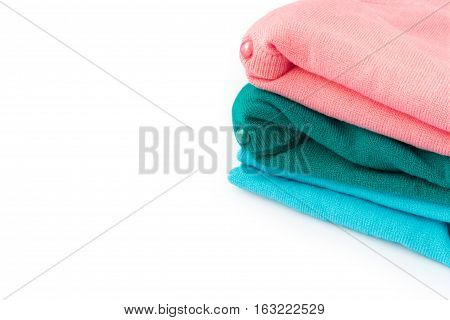 Closeup stack of clothes knitting sweater on white background