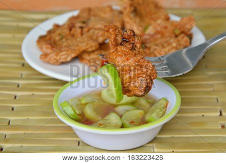 fried fish patty dipping sauce stab in fork