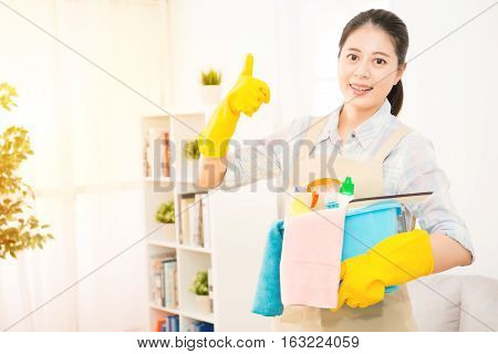 Woman Holding Detergents Thumbs Up