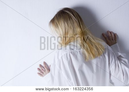 Young woman with depression isolated on white background