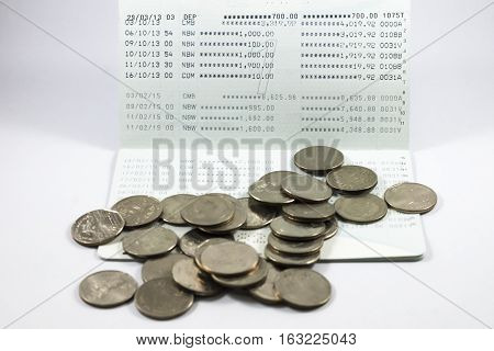 Many coin on the book bank on white background.