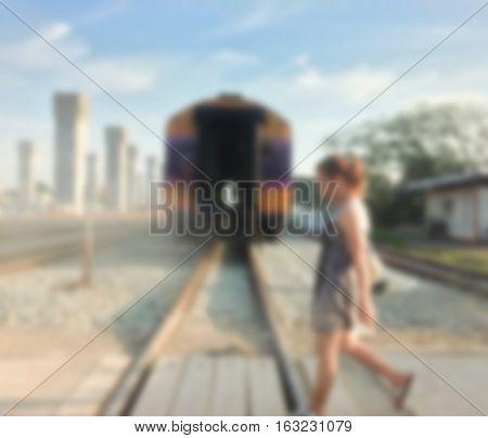 blurred woman crossing railroad risk when crossing rails.