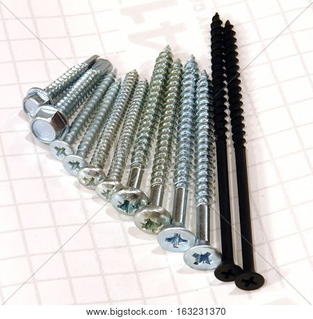 tool screws and screws on white background
