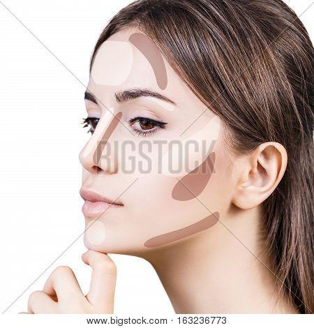 Young woman's face with contouring makeup. Contour and highlight makeup concept.