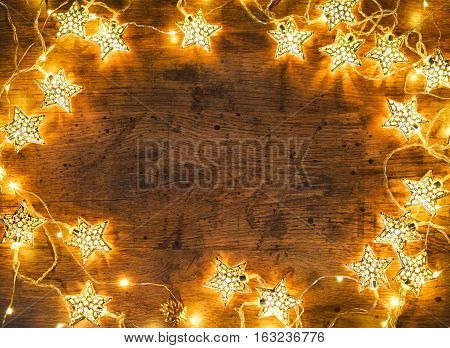 Christmas wooden background with lights. Merry Christmas and Happy New Year!! Top view.