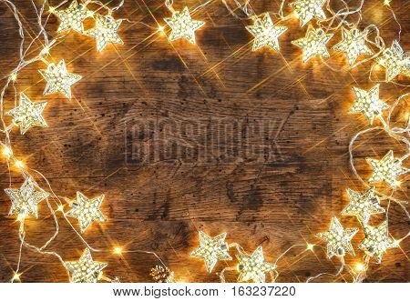 Rustic board with garland of stars. Top View. Merry Christmas and Happy New Year!!