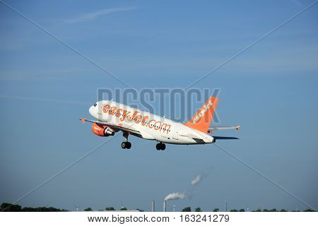 Amsterdam the Netherlands - June 9th 2016: G-EZFT easyJet Airbus A319-111 takeoff from Polderbaan runway destination Prague Czech republik