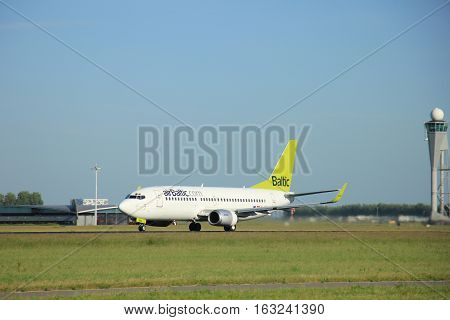 Amsterdam the Netherlands - June 9th 2016: YL-BBL Air Baltic Boeing 737-33V(WL) takeoff fro Polderbaan runway destination Riga Latvia