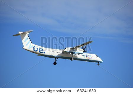 Amsterdam the Netherlands - July 15th 2016:G-JECK Flybe De Havilland Canada DHC-8 approaching Polderbaan runway at Schiphol Amsterdam Airport arriving from Birmingham Spain