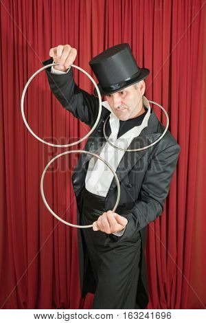 Magician Separating Iron Rings