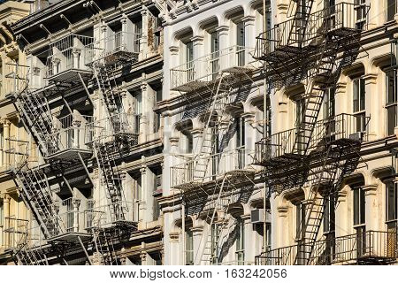 Soho building facades with fire escapes. Manhattan New York City poster
