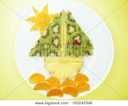 creative fruit dessert for child funny form man sailing in the ship