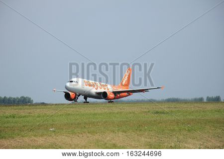 Amsterdam The Netherlands - June 12 2015: G-EZIW easyJet Airbus A319-111 takes off at Amsterdam Airport Schiphol Polderbaan runway. EasyJet is a British low-cost airline carrier based at London Luton Airport
