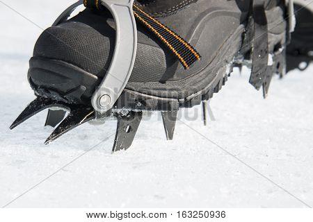 Crampons Bite Into Hard Snow. Climbing Equipment.