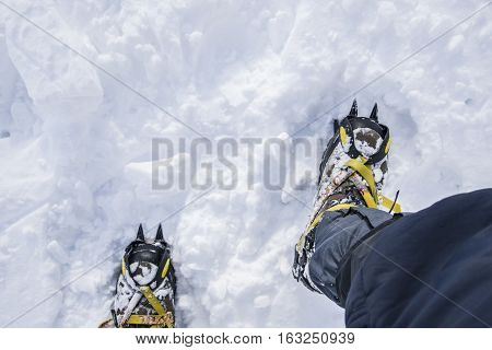 Crampons bite into hard snow. Very important equipment for walking on snow and ice.