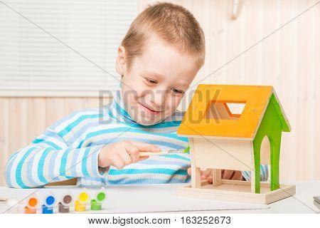 Happy Boy Is Preparing A Bird Feeder, Her Paint