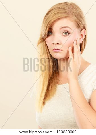Face expression emotions concept. Sad cute young blonde attractive woman in white t shirt feeling toothache