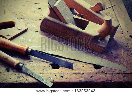 planer and chisels and other tools in the ancient workshop of the carpenter