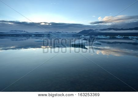 Icelandic glacial lake with mountains in the background.