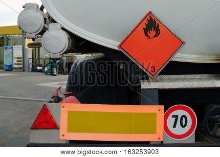 back of tanker truck taken at a refueling station.
