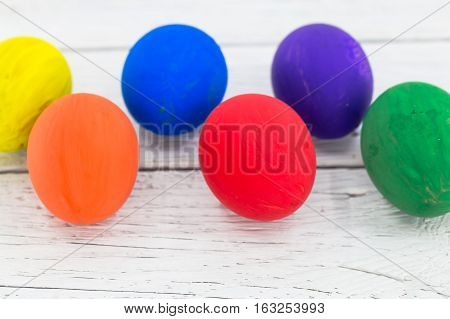 Colorful Eggs On Wooden Background