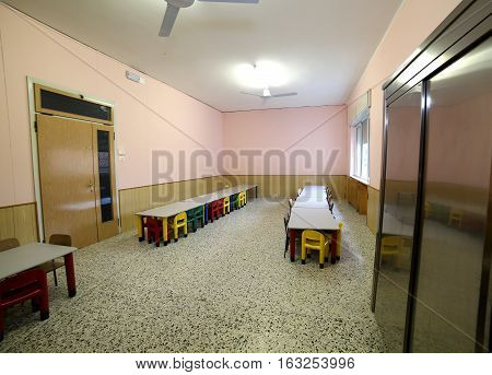 Refectory Classroom Nursery With Small Benches And Plastic Chair