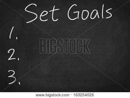 set goals concept word on blackboard background