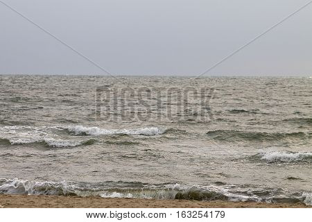 beach and stormy sea overcast day close up