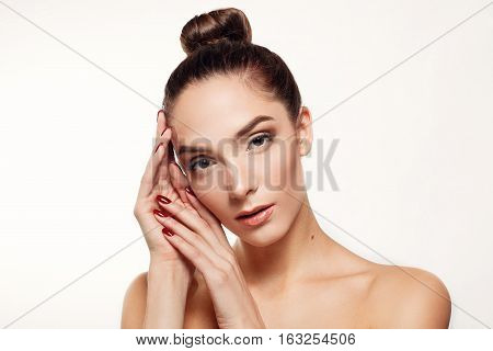 health people and beauty concept - Beauty Woman face Portrait Beautiful Spa model Girl with Perfect Fresh Clean Skin. Brunette female looking camera smiling nude makeup
