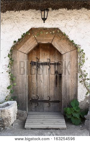 the door to the ancient Ukrainian hut closeup