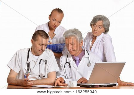 group of doctors on meting, discussing against white background