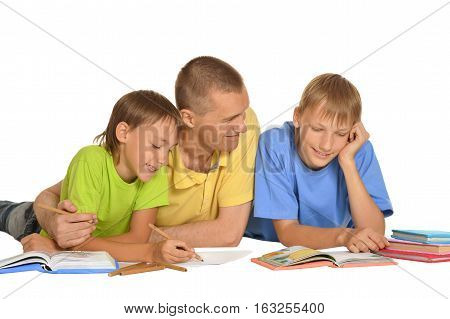 father with sons doing homework, on white background