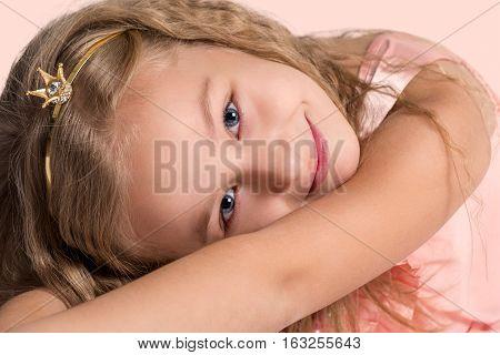 Princess. Portrait of cheerful beautiful little girl