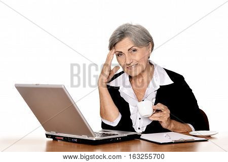 senior woman working with laptop at office