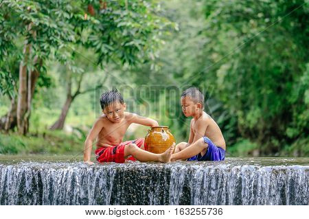 Penampang,Sabah-Oct 29,2016:Happy kids having fun with water in Babagon river,Penampang,Sabah on 29th Oct 2016.Babagon river is one of the most beautiful rivers in Sabah,Borneo.