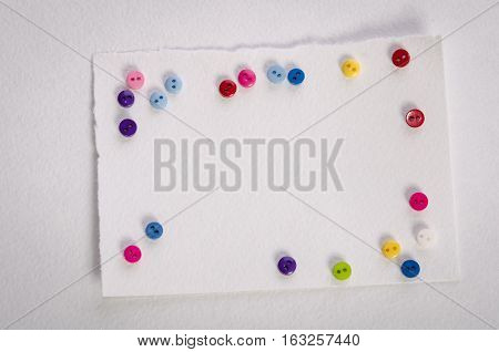 Empty card and colorfull buttons on white background