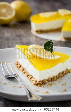Delicious sweet Lemon pie on wooden background