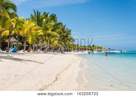 Le Morne Mauritius - December 7 2015: People are relaxing on the Le Morne Beach one of the finest beaches in Mauritius.