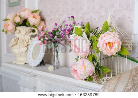 decorations with flowers on the shelf in the interior in the living room.