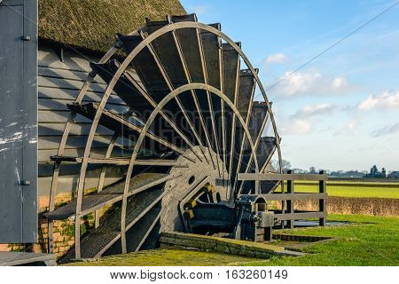Closeup of the paddle wheel of an old hollow post mill in a Dutch polder. The mill was built in 1700.