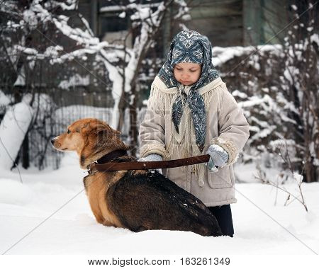 The little girl shakes mittens snow dogs