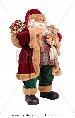 Full Length Portrait Of A Santa Claus Posing With Full Bag Of Gifts Isolated On White